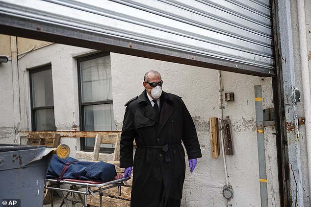 Pictured: Funeral director Tom Cheeseman collects a body from a Brooklyn nursing home