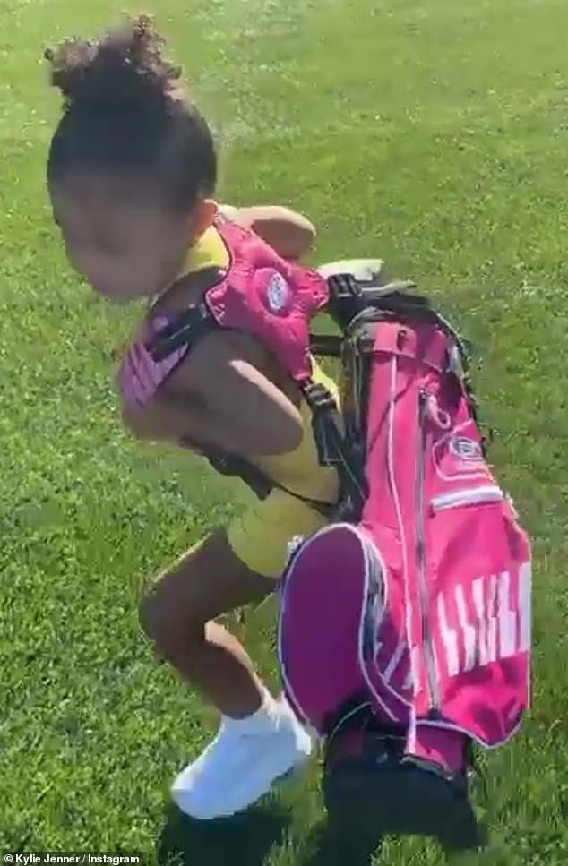 Fore! Kylie Jennerhit the golf course Friday in Palm Springs with Stormi and family, as she gushed over the cutest little caddy and her pink golf bag