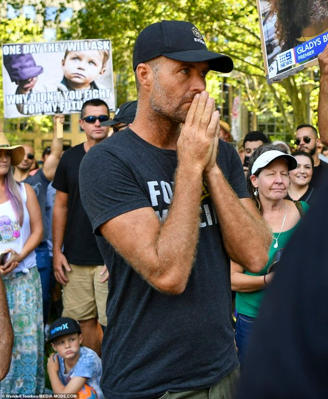 Celebrity chef Pete Evans is seen at the Sydney anti-vax march on Saturday and gave a speech to the cheering crowd