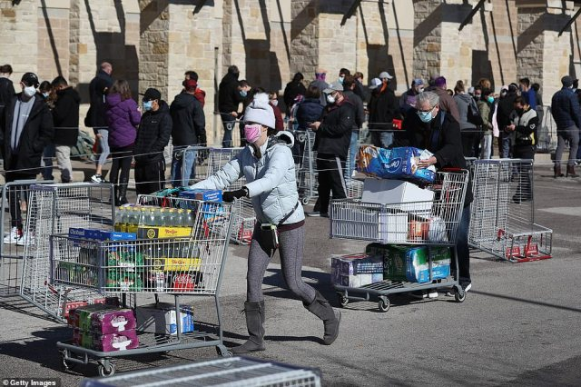 The recent weather has the supply chain to stores causing many stores to run out of food supplies for customers. Pictured are shoppers at a Costco on Saturday