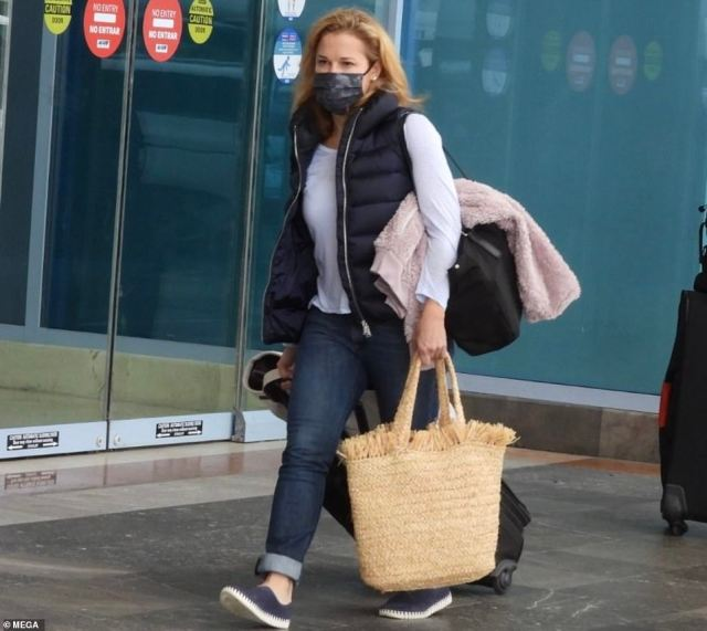 The 48-year-old kept her head bowed as she walked into the terminal alongside Catherine, 12, and Caroline, 10, after their controversial stay at the $300-a-night Ritz Carlton resort