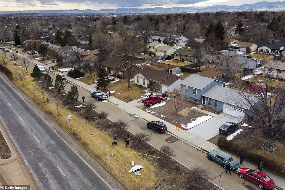 The aerial image above shows a piece of an airplane that fell from United Flight 328 sitting in the median of Sheridan Boulevard in Broomfield, Colorado on Saturday