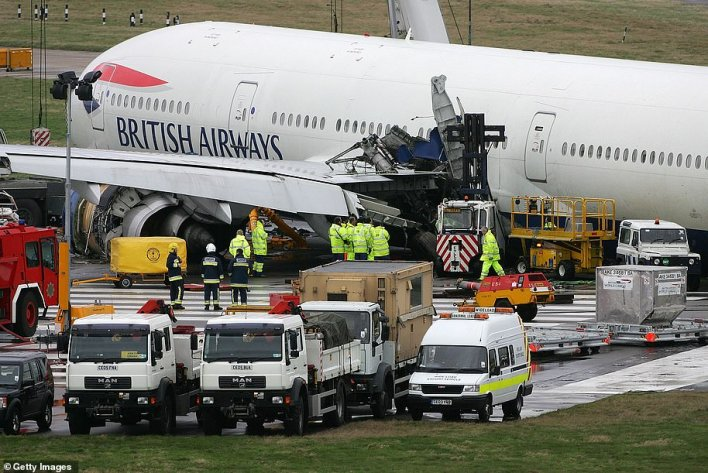Crash investigators inspect wreckage and debris from grounded British Airways Flight 38 at Heathrow Airport on January 18, 2008
