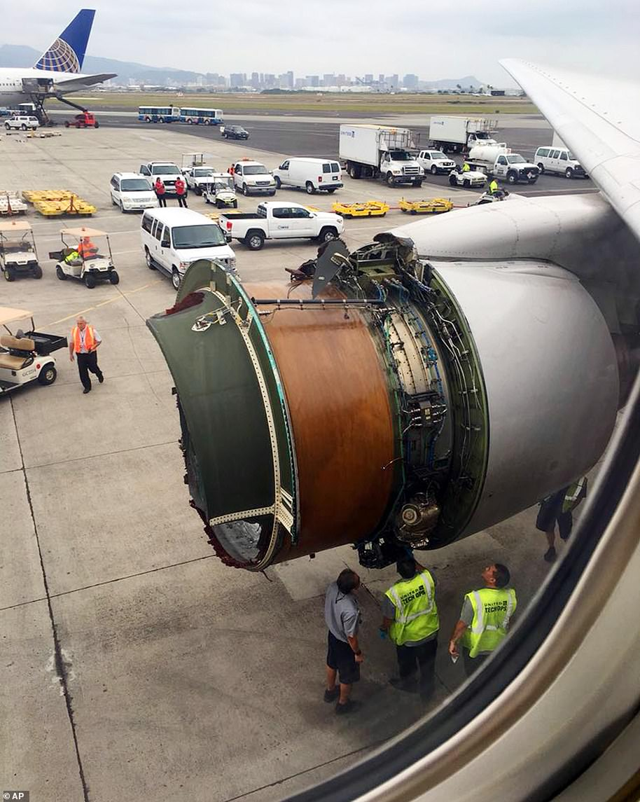 This photo provided by passenger Haley Ebert shows damage to an engine on what the FAA says is a Boeing 777 after parts came off the jetliner during its flight from San Francisco to Honolulu on February 13, 2018