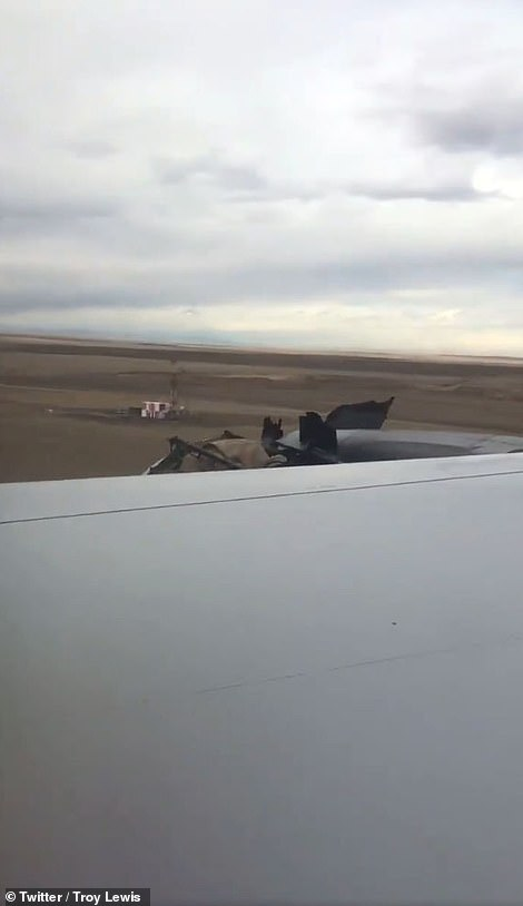 The image above was taken by a passenger on board. It shows the damaged engine as seen from inside the cabin