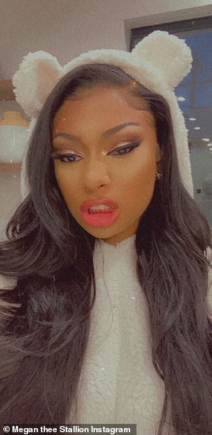Cheeky: The WAP star puckered up her lips in playful manner in another photo