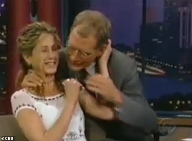 'Creepy': Letterman suddenly emerges from behind his desk and, unbidden, approaches Aniston and grabs some of her hair