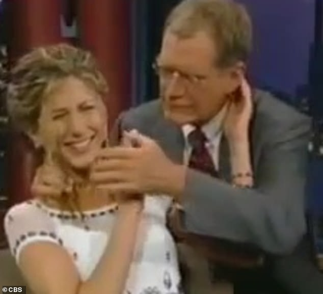 Get off!With one hand on her neck, Letterman continues regardless of Aniston's clear discomfort