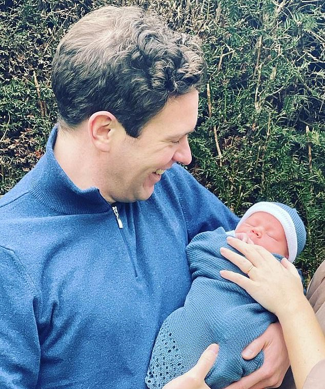 Proud: In the first photographs of the family-of-three, Jack cradled newborn August in his arms, a sign he's ready to be a hands-on dad