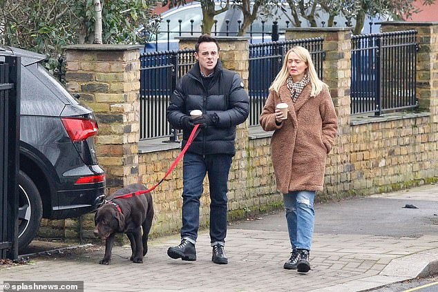 Stepping out: Fresh from the return of Ant & Dec's Saturday Night Takeaway this weekend, Ant McPartlin enjoyed a stroll on Sunday with his fiancée Anne-Marie Corbett and their beloved pooch Hurley