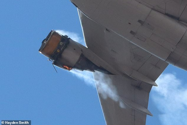 Flames could be seen coming from the engine of the plane after it exploded at 15,000ft. Miraculously, nobody was injured