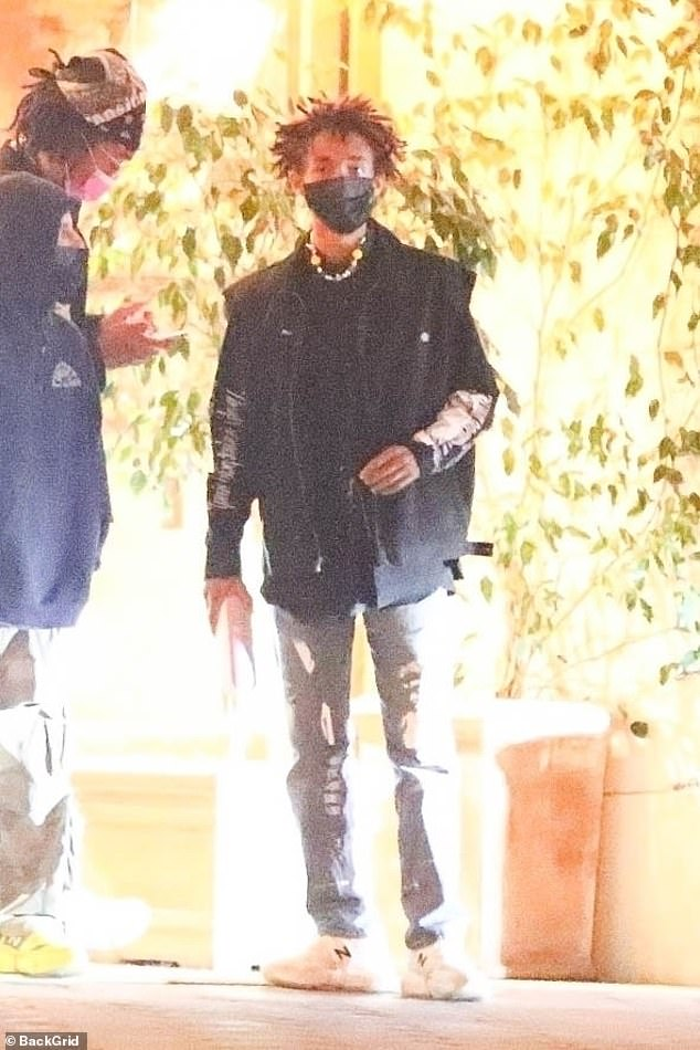 Boy's night: Jaden Smith and his friends enjoyed a late dinner in LA over the weekend, opting to go out without his new flame Cara Delevingne, who he was first seen smooching last Sunday