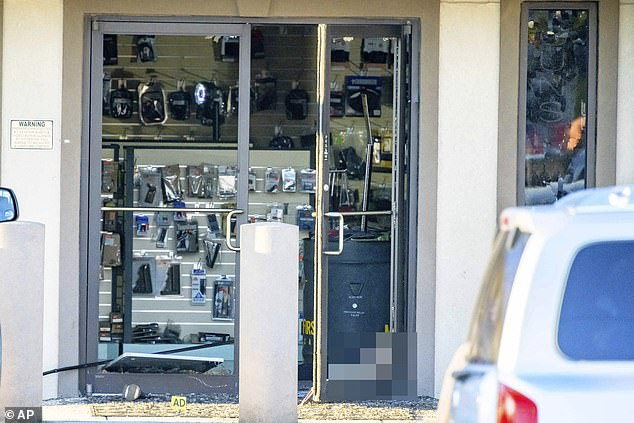 A female victim of Saturday's shooting in Metairie was shot dead in the doorway of Jefferson Gun Outlet