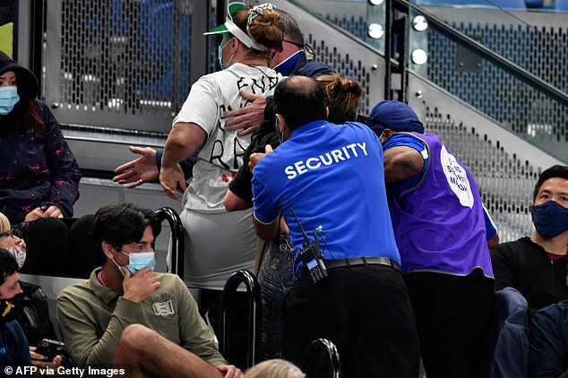Protesters interrupted the match during the second set and had to be escorted out of the arena by security guards
