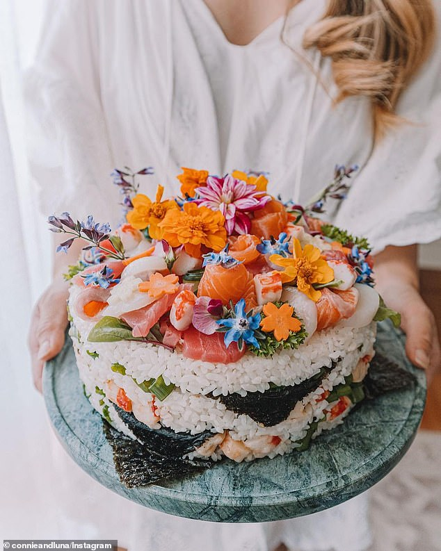 Sheshared an Instagram Reel showing exactly how she assembled the savoury birthday cake -- complete with sashimi, seaweed, edible flowers and floral shaped vegetables