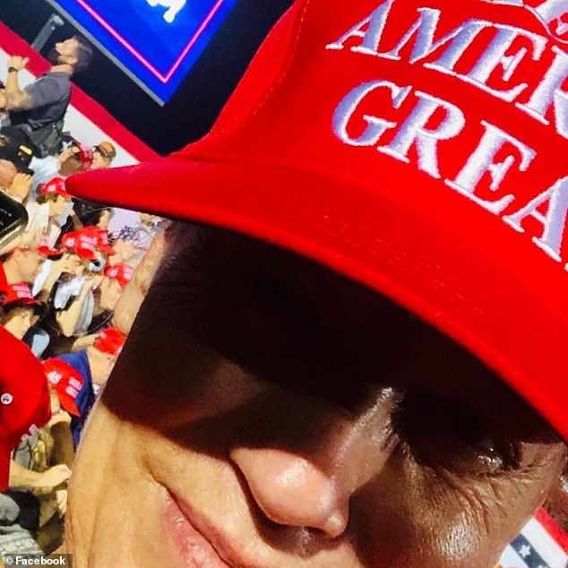 On her now-deleted Facebook page, Wright had posted several pro-Trump memes. In one of her photos (pictured), she's seen wearing a Make American Great Again hat and shared a post that read: 'It's Okay To Be White'