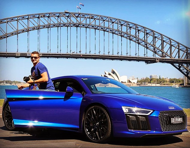Flash sportscar: Mr Koletti drives a $300,000 electric blue Audi R8. Above, the former Joh Bailey hairdresser poses with his pride and joy in front of the Sydney Harbour Bridge