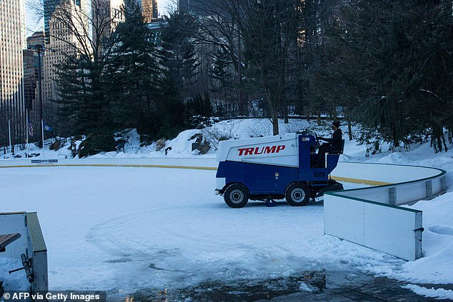A worker drives a Zamboni ice resurfacer painted with the Trump logo on the Wollman ice skating rink on February 21