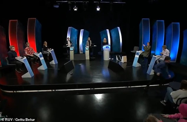 The young man storms through the studio (bottom right) before even more commotion is heard off screen