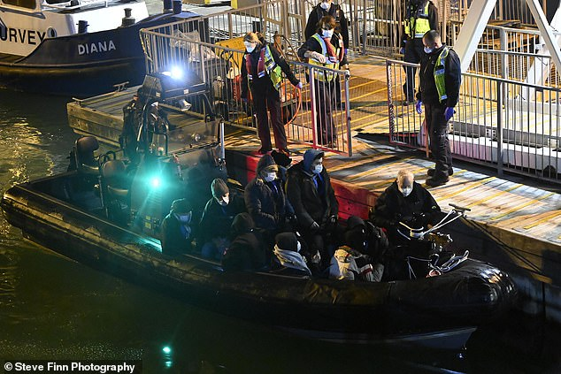 The migrants were escorted across the busy waterway by French authorities, sources say