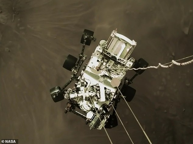 NASA shared an exciting image shot by the sky crane that shows Perseverance, nicknamed Perky, slung beneath and attached to mechanical bridals ¿ moments before making landfall. NASA believes this image will become an iconic picture of spaceflight history