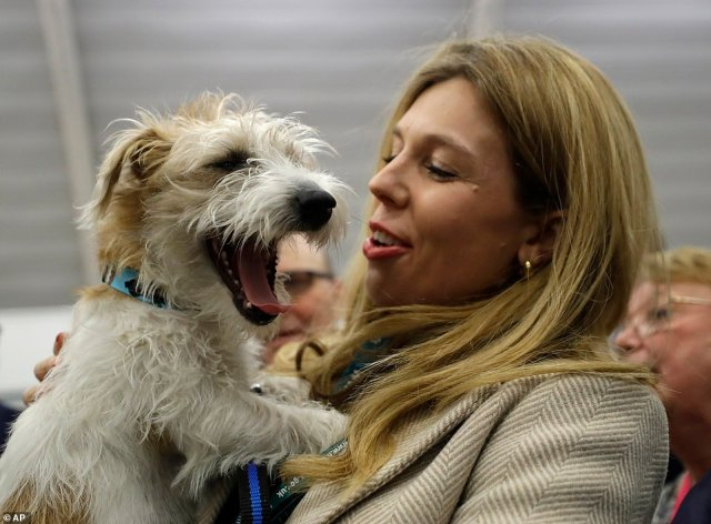 Carrie Symonds holds Dilyn after arriving for the Uxbridge and South Ruislip constituency count declaration at Brunel University in Uxbridge, London, in December 2019