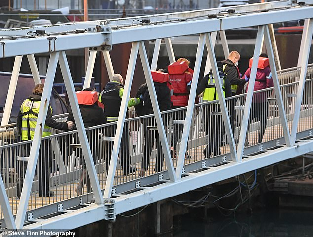 They arrived in Britain this morning after being escorted to shore by French and British authorities