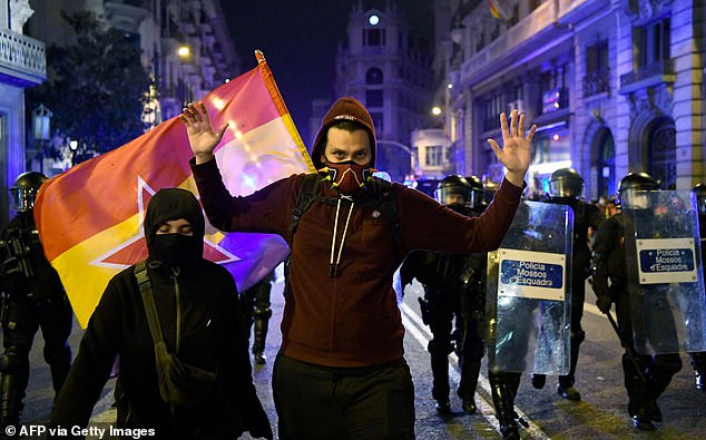 Known for his hard-left views, Hasel was handed a nine-month sentence over tweets glorifying terrorism and videos inciting violence. Pictured: Protesters and police on Sunday