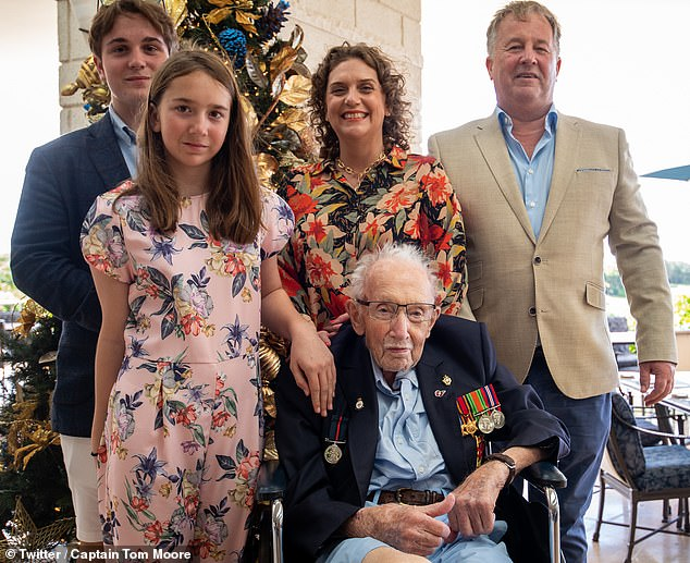 Captain Tom is pictured in Barbados last December with (from left) grandchildren Benjie and Georgia, their mother Hannah, who is Captain Tom's daughter and father Colin Ingram-Moore