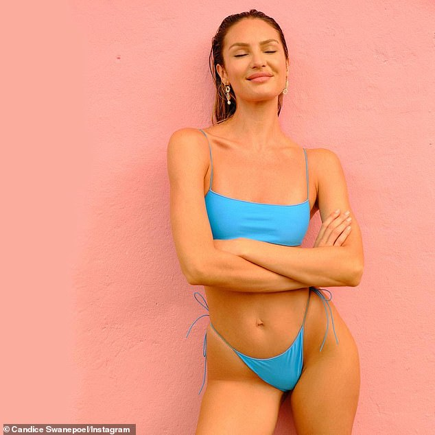 On target:The 32-year-old model from South Africa was showing off her incredibly toned figure as she posed against a pink backdrop to push her successful Tropic Of C line