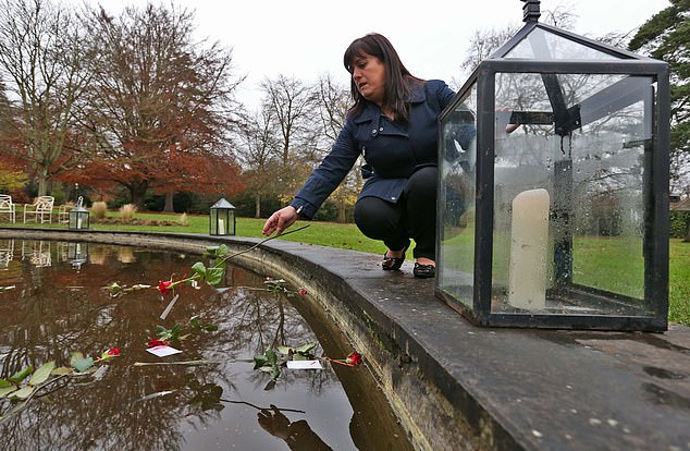 Berna Fidan, sister of Esra Uyrun who went missing in February 2011 throws a rose into the pond pictured at Farmleigh this afternoon for Missing Person's Day 2014
