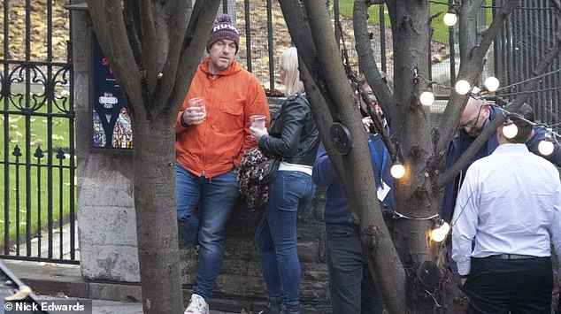 Members of the public have outdoor drinks at Borough Market, London, late last year