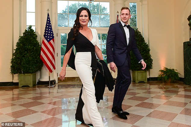 Politico first reported that Max Miller (right) is exploring a bid for Congress to take on Rep. Anthony Gonzalez, who voted in favor of President Donald Trump's impeachment. Here he accompanies then White House press secretary Stephanie Grisham (left) to the White House State Dinner with Australia