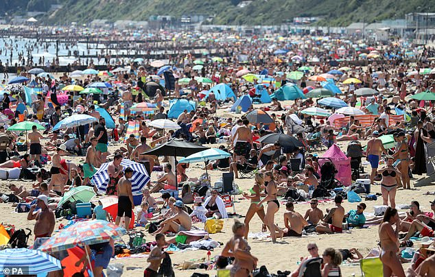 Britons desperate to get away this summer have been arranging high-end staycation plans in the UK. Pictured: Bournemouth beach
