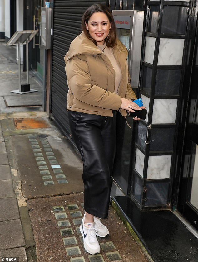 Low-key look: Kelly Brook opted for a comfortable but stylish ensemble as she arrived at the Global Radio studios in central London on Monday