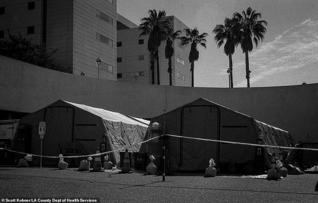 As cases in New York City surge, disaster tents are erected and await use outside of the Los Angeles County-USC Medical Center emergency department in preparation for the worst