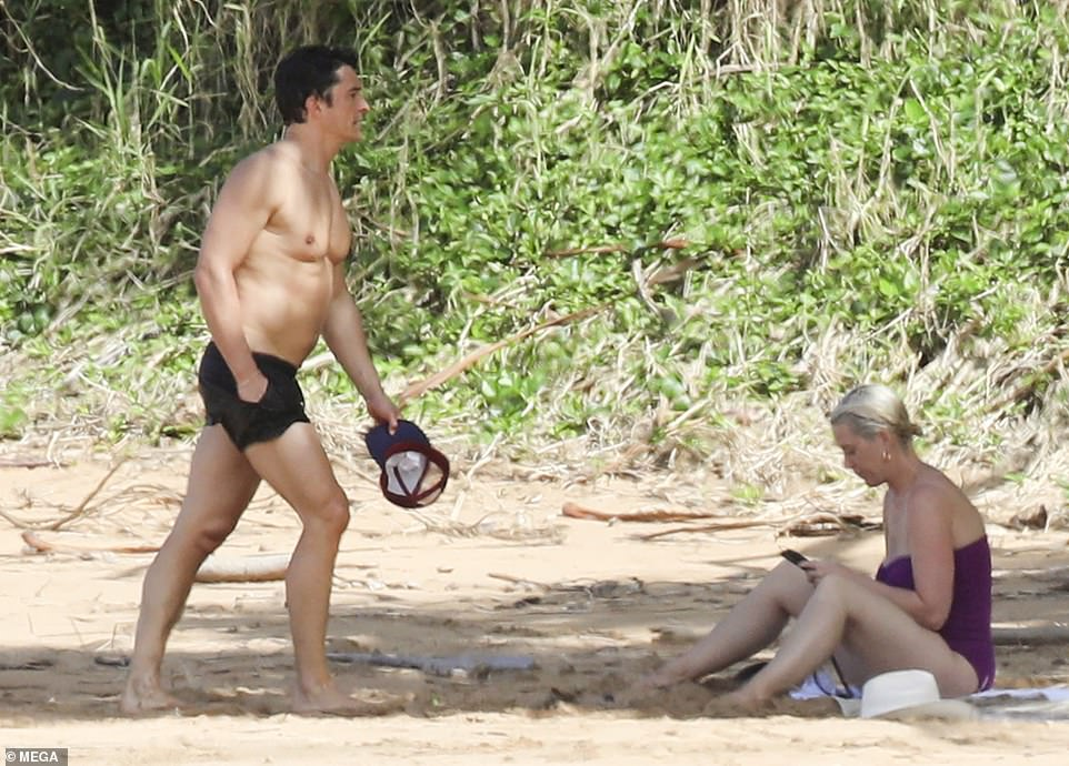 Couple's retreat: She was joined be her fiance, who looked handsome while on the shore
