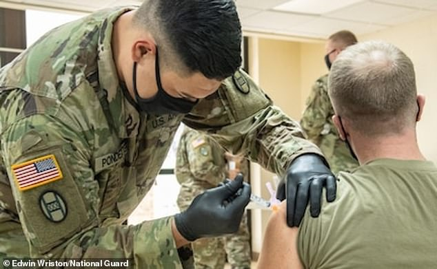 One of the keys to West Virginia's success is enlisting the help of the National Guard. Pictured: Members of the West Virginia National Guard conduct and participate in a COVID-19 vaccination clinic at Joint Forces Headquarters, Charleston, West Virginia, January 2021