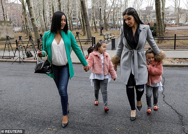 Coronel is pictured with Emali and Maria Joaquina, born in 2011, in February 2018 in New York