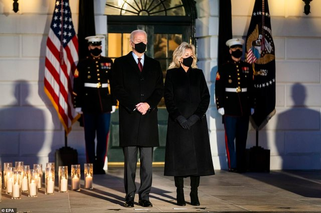 Prayer: The Bidens closed their eyes during the moment's silence, and the president made the sign of the cross when it ended