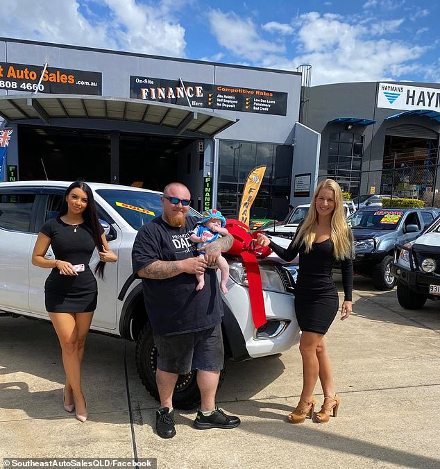 Pictured: Three babes and a bloke pose for a photo with a new car at Southeast Auto