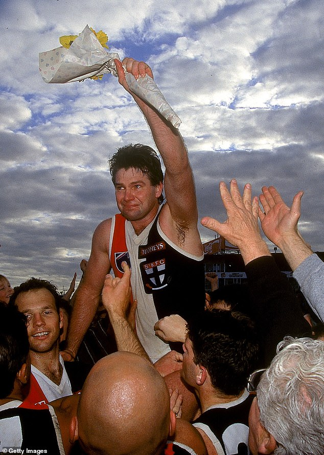 The report said from April 2019 Frawley 'became increasingly erratic and began to eat and drink in excess'. Above, he is cheered off the ground after his last match in 1995