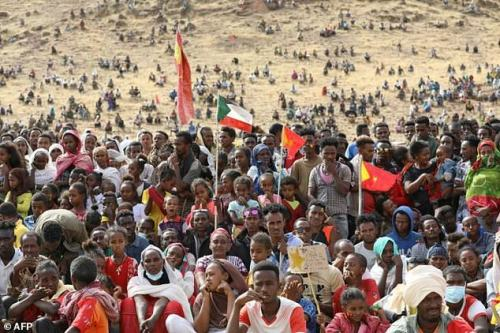 Ethiopian refugees gather to celebrate the 46th anniversary of the Tigray People's Liberation Front at Um Raquba refugee camp in Gedaref, eastern Sudan, on February 19, 2021