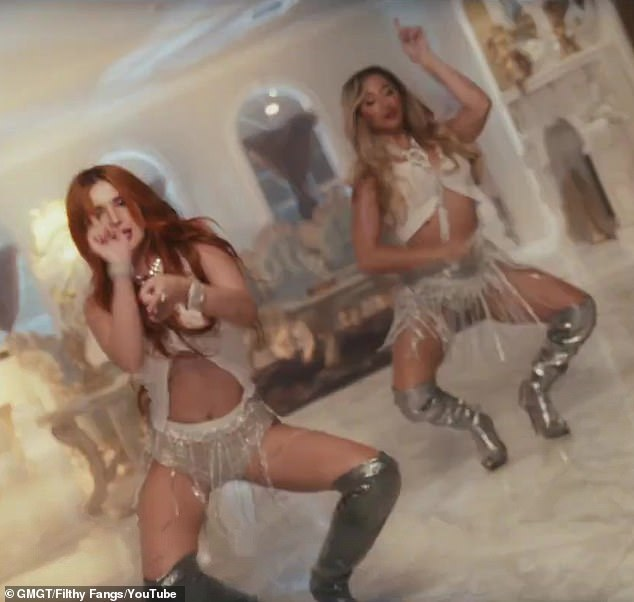 Oh my!Bella Thorne sizzled in her music video for Shake It, in which she enjoyed steamy romps with porn star Abella Danger, with both the stunners donning bridal lingerie