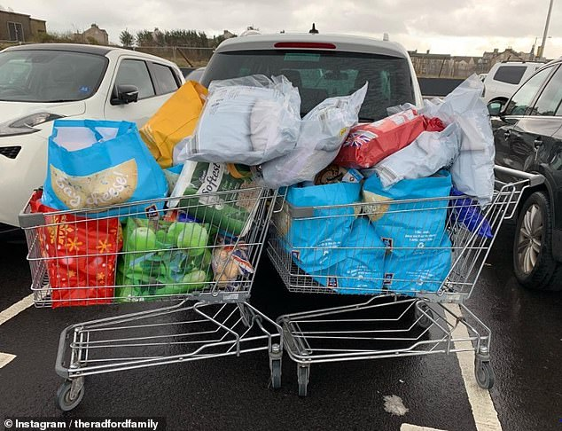 An example of Sue's foodhsop for her family, which takes several shopping trolley filled to the brink