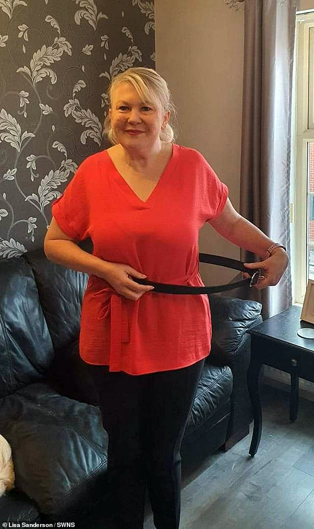 Lisahad two successful surgeries, five chemotherapy sessions and 23 radiotherapy sessions over the course of six months. Pictured: Lisa holding a belt she use to wear when she was 17st