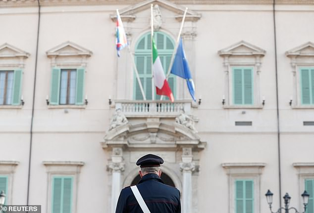 Pictured: A Carabinieri officer looks at the Italian flag that flies at half mast next to EU and Presidential Standard of Italy flags, outside the Presidential Quirinale Palace, following the death of the Italian ambassador to the Democratic Republic of Congo