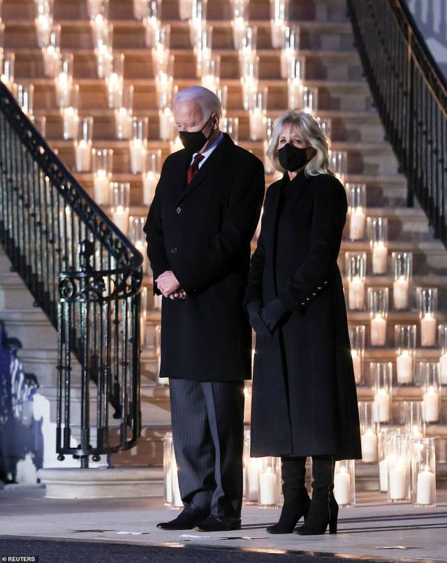 Candles of memory: The White House placed 500 candles on the South Portico, one for each of the thousand people who have died
