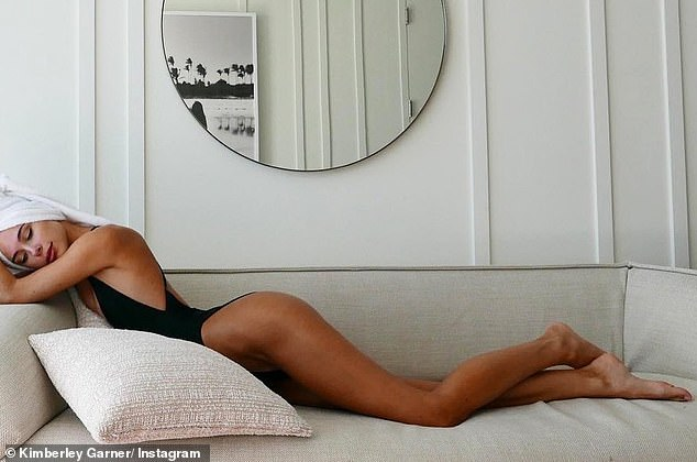 Model behavior: The former Made In Chelsea star looked every inch of the classic pin-up model as she posed on her sofa in the swimsuit inspired by the retro costumes from 1971