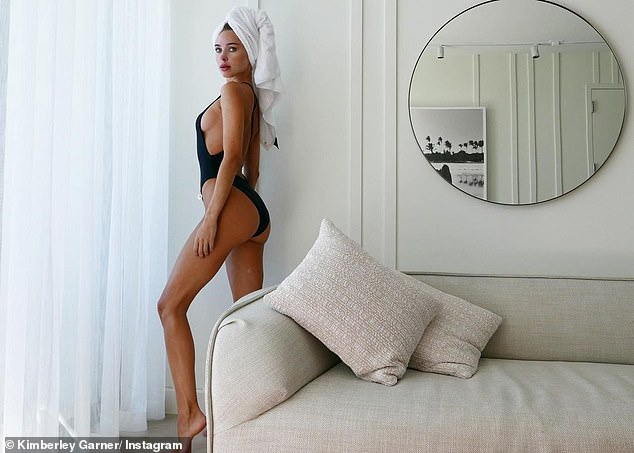 The Perfect Fit: Kimberley's new swimsuit featured a high-waisted leg, side cutouts and crisscross open back, which perfectly showcased the former reality star's curves
